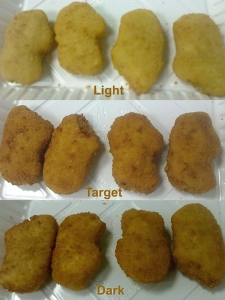 Breaded chicken meat nuggets showing Light-Target-Dark grades